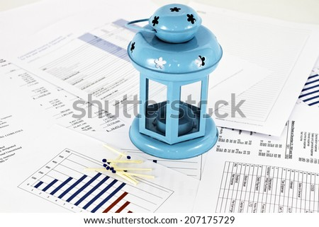 Candle lamp with matches on electrical business background showing concept of success an idea - stock photo
