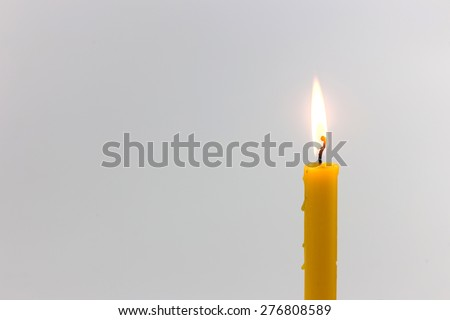 Candle light  for spirituality ceremony against grey background - stock photo