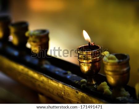 Candle light for worship Buddha - stock photo