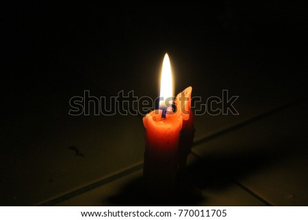 Candle light in darkness