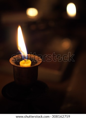 candle light in the dark, space for caption
