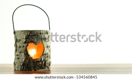 Candle light lantern with a heart shaped window, subtle romantic decoration for winter holidays and Valentines, just add your text on the right.