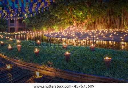 Candle Light with Buddha Statue at Pan Tao Temple, Chiangmai, Thailand - stock photo