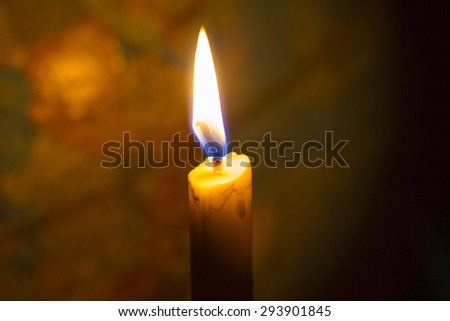 Candle light with  bur world globe  as a  background, copy space - stock photo