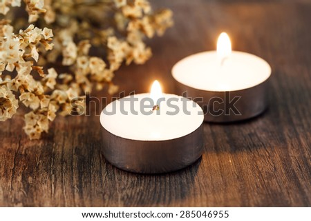 Candle light, with focus on a flame - stock photo