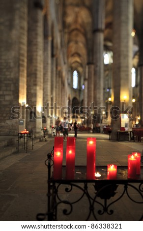 Candle lights in a gothic cathedral - stock photo