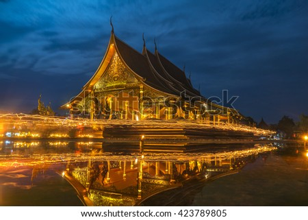 Candle lit, At Sirindhorn Wararam Phu Prao Temple (Wat Phu Prao) at twilight of Vesak Day, Peoples come to worship the Buddha,Candle lit walk around the temple, Ubon Ratchathani Province, Thailand, - stock photo