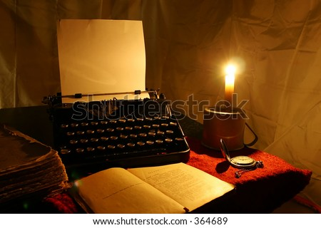 candle, old typewriter and old book - stock photo