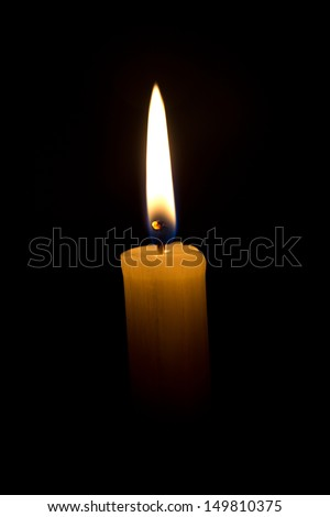 candle on a black background - stock photo