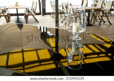 candle on a grand piano in a restaurant - selective focus, copy space
