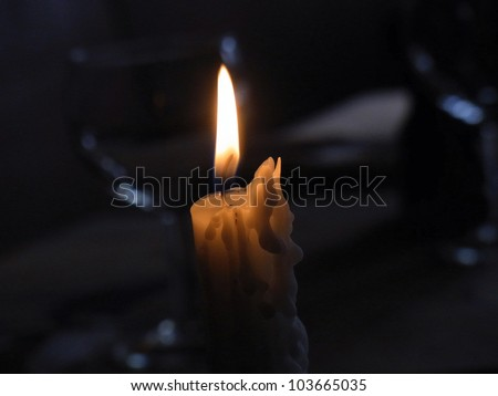 Candle on a table of restaurant - stock photo