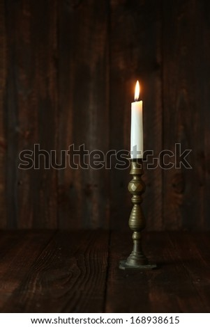 Candle on an Old Wooden Rustic Background