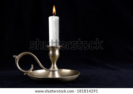 Candle on the old brass candlesticks - stock photo