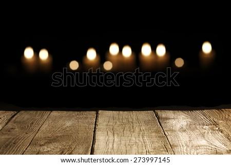 Candle on wood background - stock photo