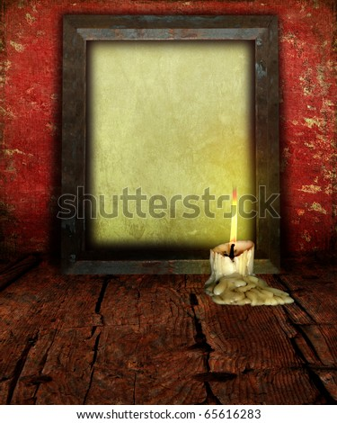 Candle Stub and Empty Picture Frame with Antique Paper on rustic moody background