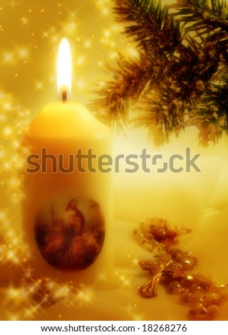 candle with pine, cross, and glittering stars as concept for christianity and christmas holidays - stock photo