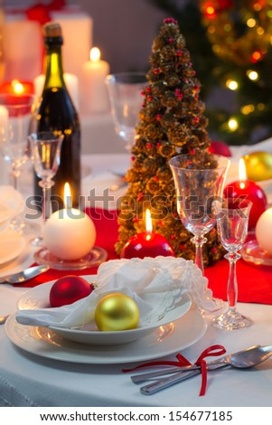 Candlelight on a table decorated beautifully for Christmas - stock photo