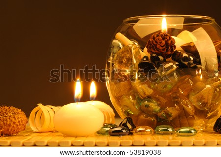 Candles and a set of the decorative stones, the flavored slices of a tree. Spa theme - stock photo
