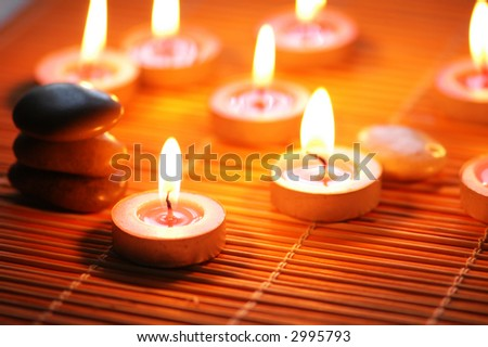 Candles and pebbles for  spa session - shallow DOF - stock photo