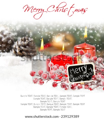 Candles and red bauble branch with sign and cones on snow - stock photo