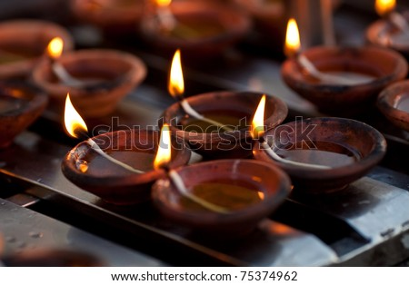 Candles at Shwedagon Paya Pagoda in Yangon, Myanmar - stock photo