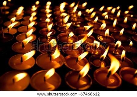 Candles at swayambhunath temple in Kathmandu, Nepal - stock photo