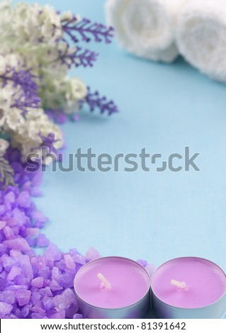 candles, bath salts and towels on a blue background - stock photo