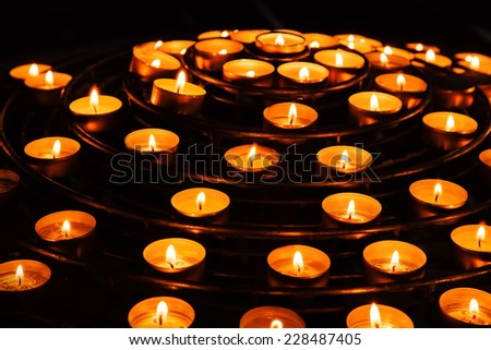 Candles burn in dark interior of Catholic cathedral