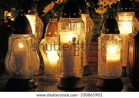 Candles Burning At a Cemetery During All Saints Day. - stock photo