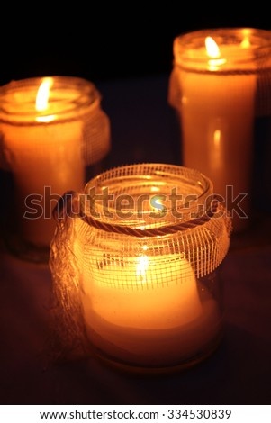 Candles Burning At a Cemetery During All Saints Day - stock photo