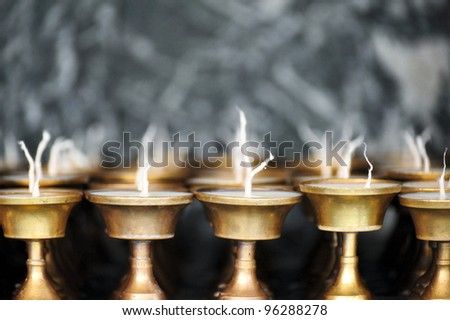Candles burning in a Buddhist temple in Kathmandu Nepal - stock photo