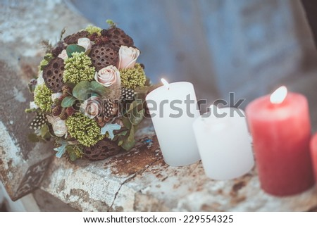 Candles burning on a stone wall at a wedding reception  - stock photo