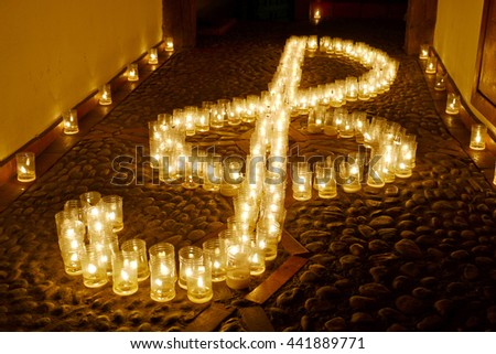 Candles drawing a treble clef