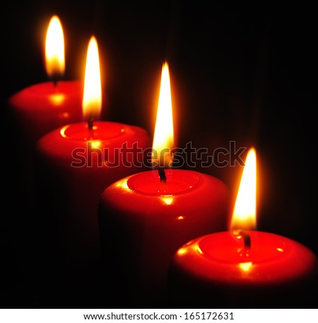 candles flaming in the dark