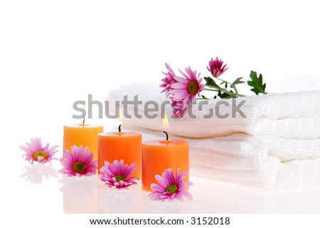 Candles, flowers, and white towels