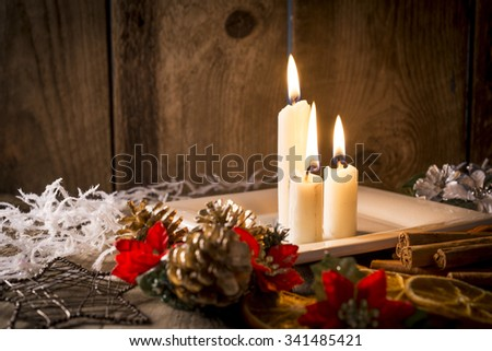 Candles in a christmassy setting and decorations