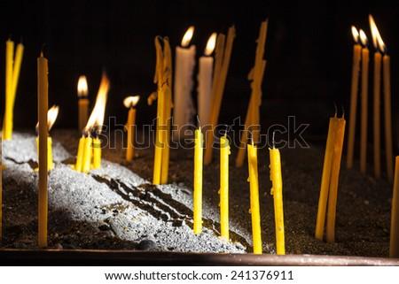 Candles in christian apostolic church in Armenia - stock photo