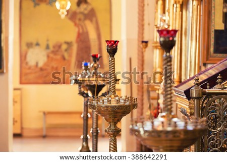 Candles in christian church. North Russia - stock photo