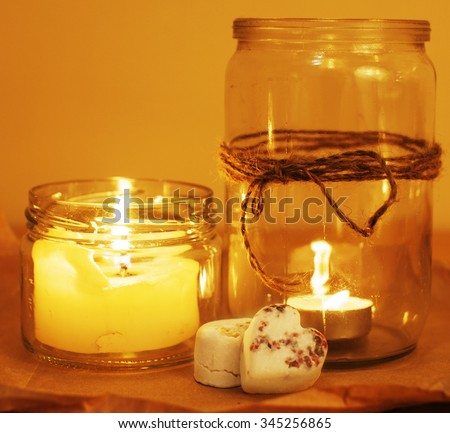 candles in glass burning romantic celecration concept wooden kitchen close up - stock photo