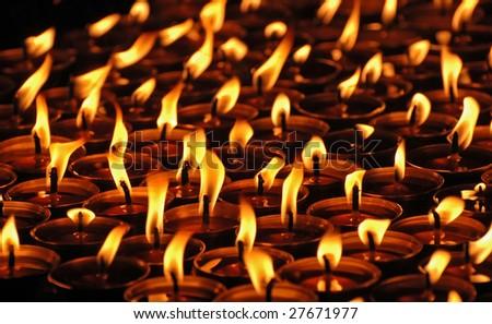 Candles in the Tibetan monastery, Nepal. - stock photo