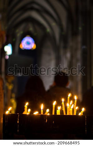 Candles inside saint Stephen's cathedral during easter holidays at downtown of Vienna, Austria - stock photo