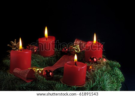 Candles isolated on a black background - stock photo