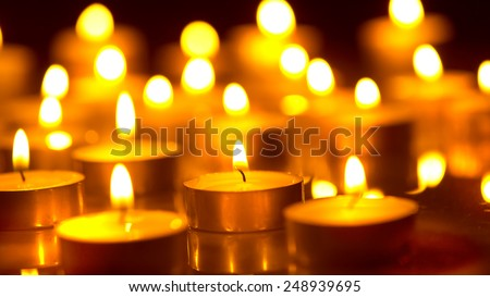 Candles light background. Candle flame at night. Holiday candles close up.m Abstract glowing background - stock photo