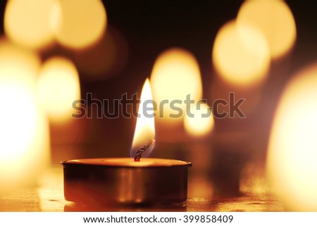 Candles light select focus, black background. - stock photo