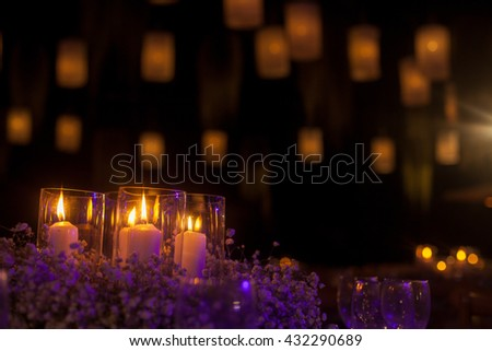 Candles light. wedding candles burning at night. Abstract candles background. Golden light of candle flame - stock photo