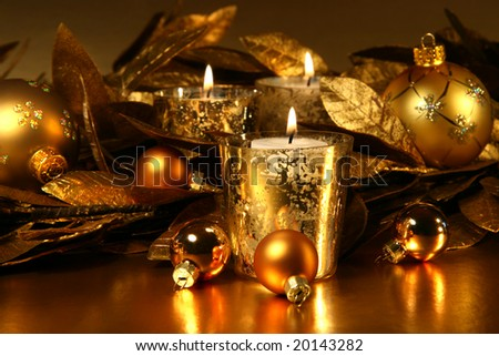 Candles light with a sparkling gold theme - stock photo