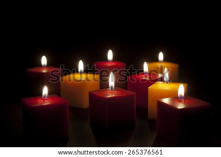 candles lighting in the darkness or in a black background