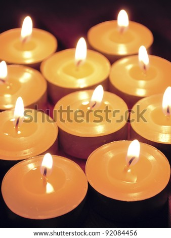 candles lights background, shallow DOF; focus on two front candles
