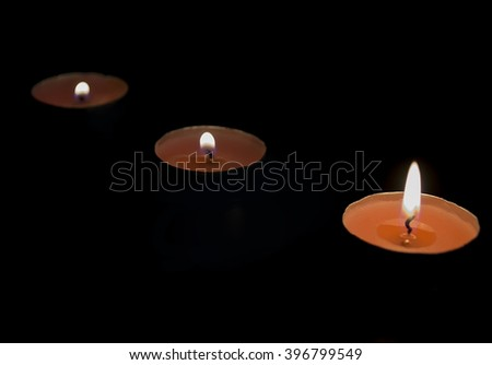 candles on a black background - stock photo