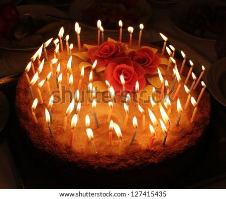 candles on a celebratory pie - stock photo
